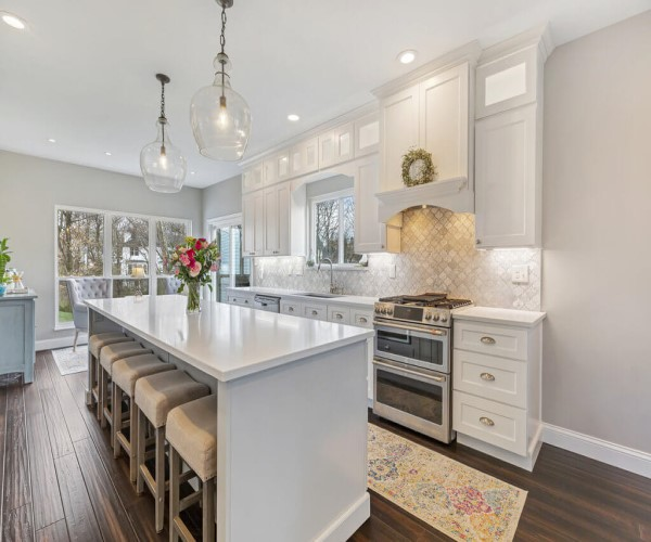 White Countertops with wood floors