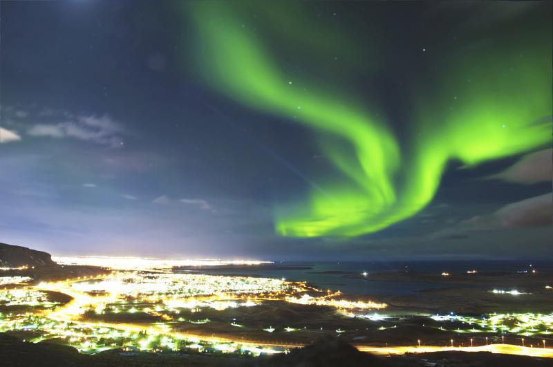 Spectacular display of green Northern Lights over Reykjavik