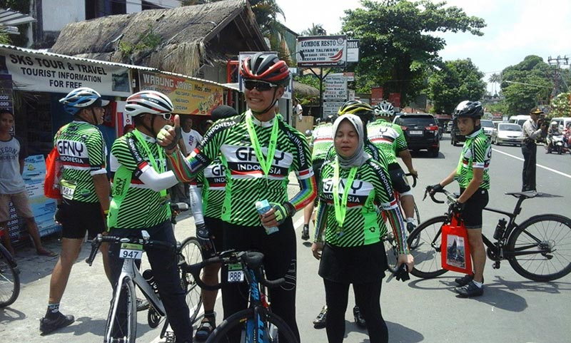 Smiling Bicycle Riders Enjoying Lombok Sporting Events Tourism