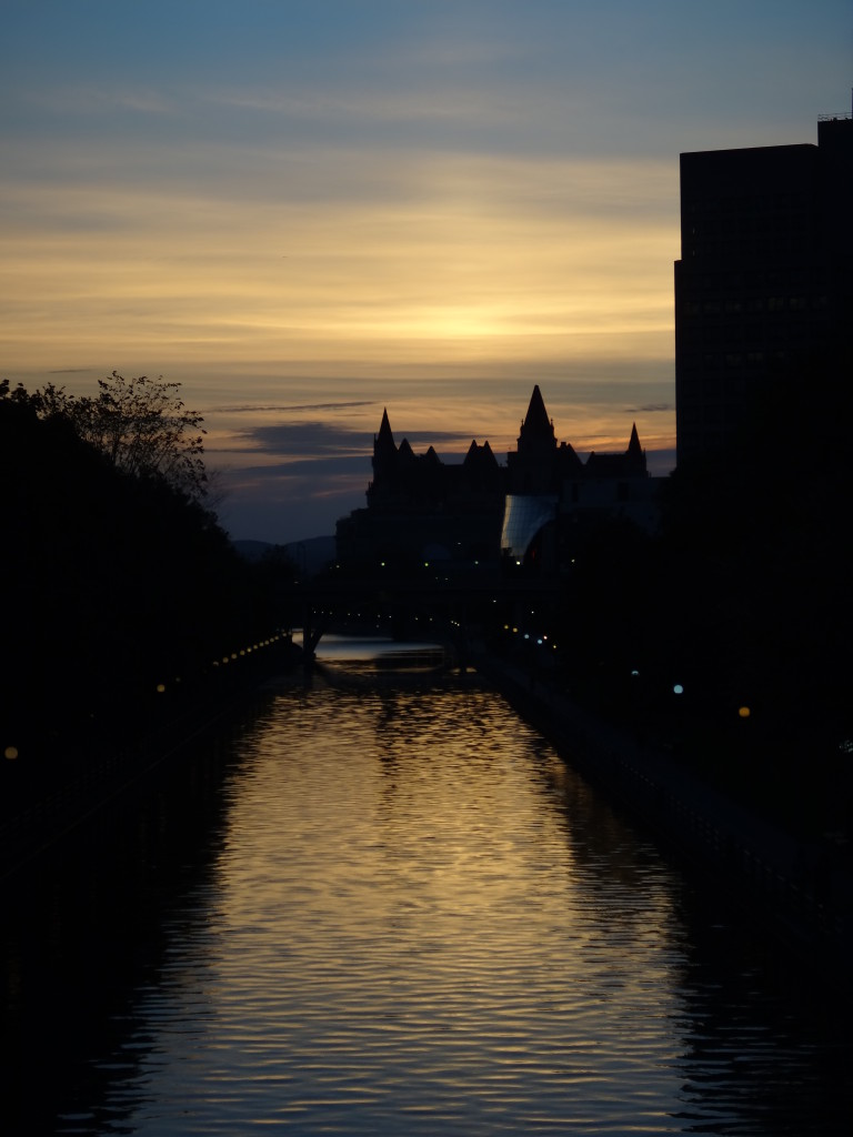 A photograph of sunset over the Rideau Canal from the Corkstown Footbridge.