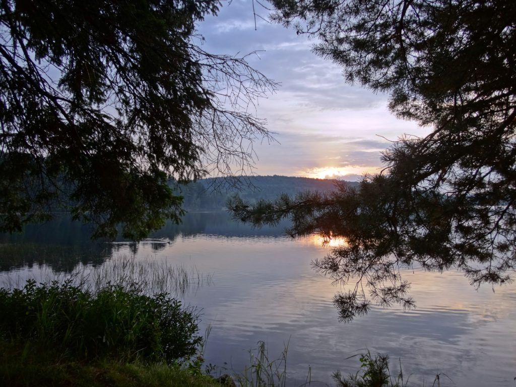 The sun rises over the Lake of Two Rivers, as viewed from Killarney Lodge.