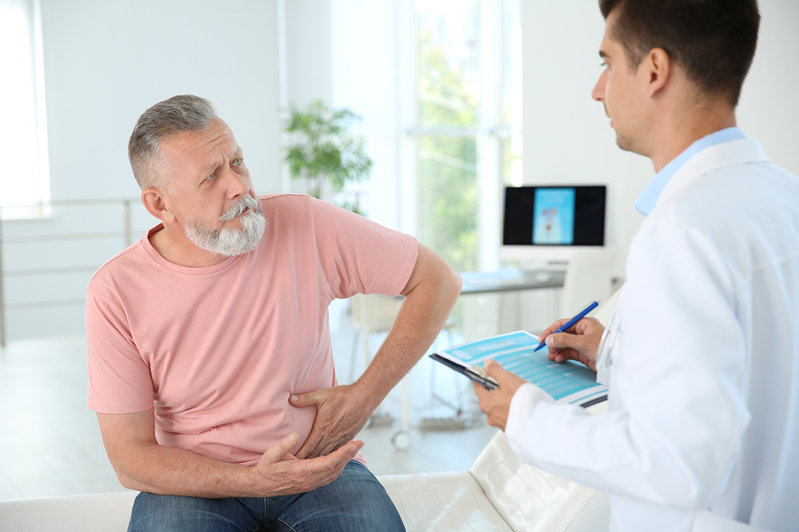 Man receiving information about urologic conditions and treatment