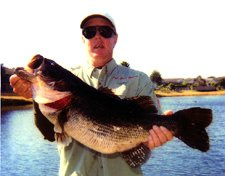 Captain Jackson with his 15lb 8oz Lake Toho Bass Fishing guide trip monster