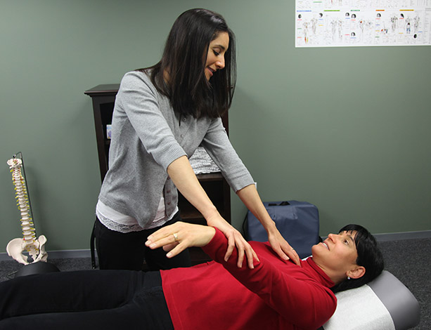 Dr. Firestone muscle testing a patient