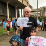 John Witech with grandchildren at march at Hawaii State Capitol