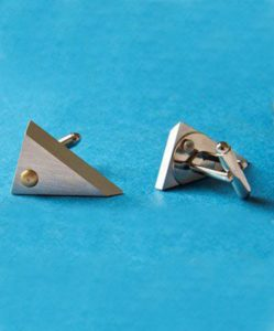 """""""Slightly Dangerous"""" cufflinks by Jerry Moran from reclaimed aircraft aluminum, $62 at museumofflightstore.org"""