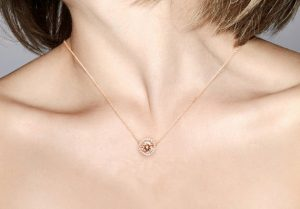 morganite and diamond halo necklace in rose gold