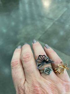 prasiolite and oregon sunstone rings with origami accents by karin jacobson