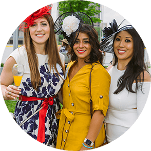 Three women in fascinators at Hats Off Luncheon