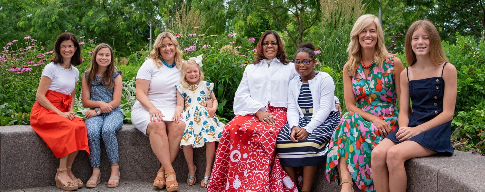 A group of women and their daughters at the Women's Committee Garden in Smale Riverfront Park