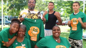 A group of volunteers wearing Ezz Fest t-shirts pose for a group photo