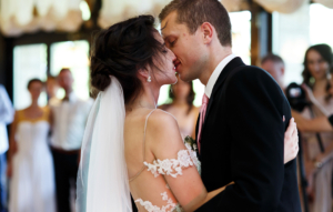 Romantic and sensual couple beautiful bride and groom dancing and kissing closeup