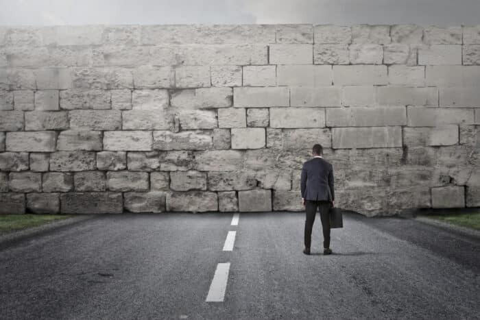 Man facing a brick wall