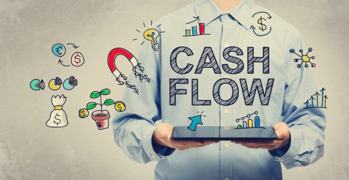 Cash Flow concept with young man holding a tablet computer - Image