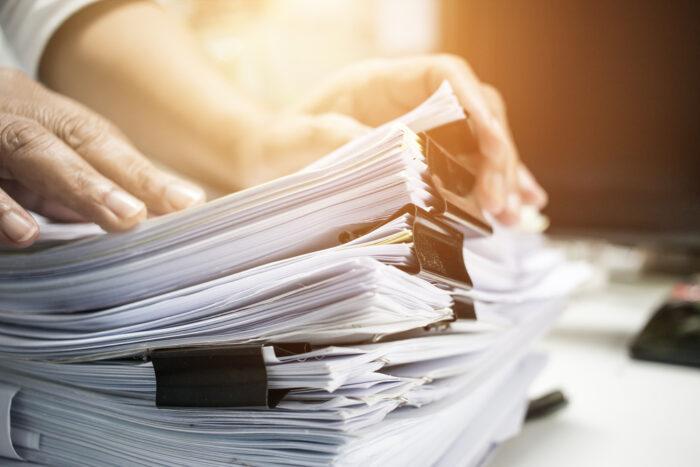 large stacks of paperwork