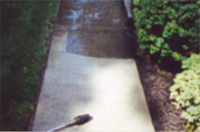 Exterior home pressure-wash cleaning of driveway