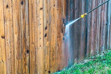 Exterior home pressure-wash cleaning of fences