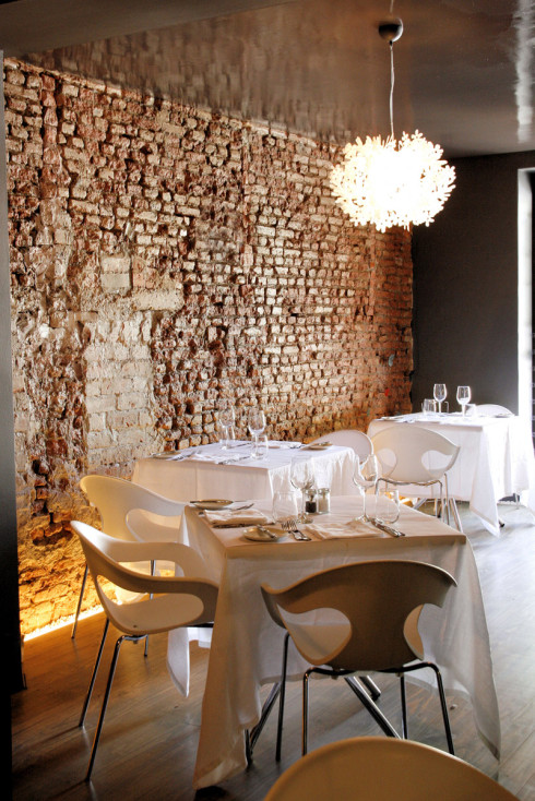 The interior at Bizerca, with their signature exposed brick wall and butterfly details.