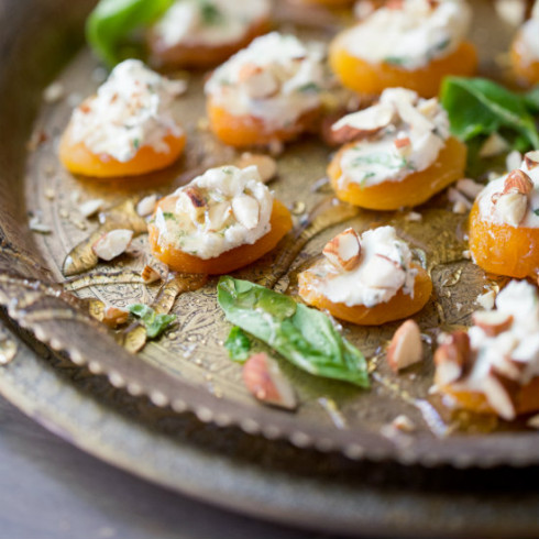 Soft dried apricots topped with basil goats cheese & almonds, drizzled with honey (photography by Tasha Seccombe)