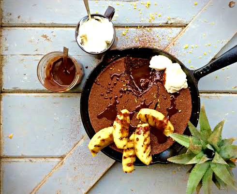 Baked chocolate pineapple pudding with almonds and orange rind, served with dark chocolate sauce & creme fraiche.