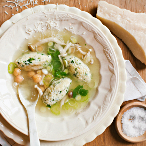 Spinach & ricotta dumplings in a light and fragrant broth, topped with parmesan cheese. (photography by Tasha Seccombe)