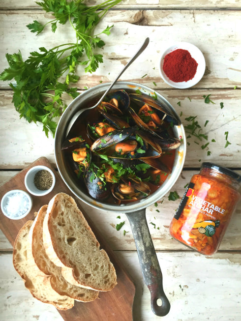 Spicy black Saldanha Bay mussels with garlic, paprika, and white wine.