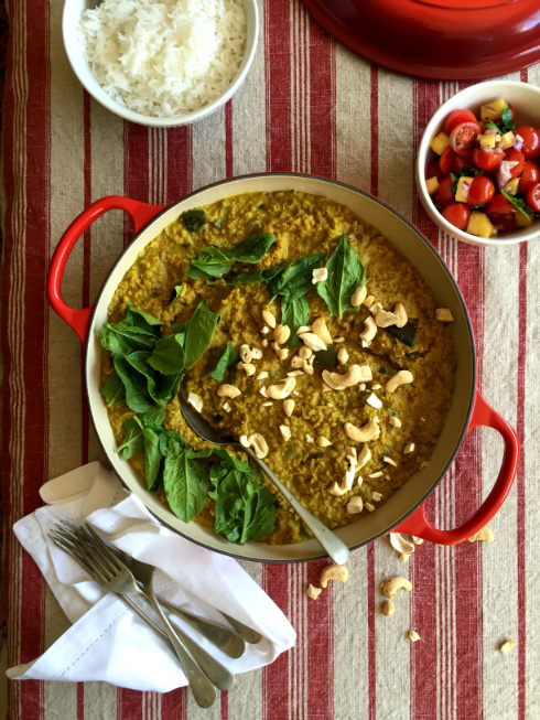A hearty pot of dhal coconut curry with aubergine, spinach and cashews - rich and fragrant.