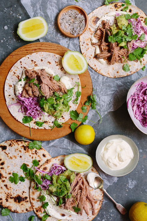 Easy BBQ pulled pork tortillas with sour cream, red cabbage slaw, avo and fresh coriander. So delicious! (photography by Tasha Seccombe)