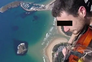 Playing the violin as he parachutes from an airplane naked.