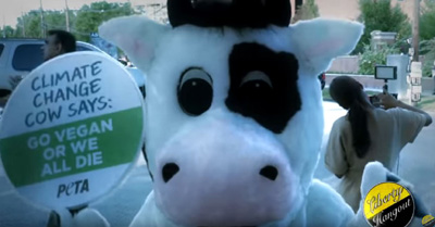 "Climate Change Cow Says ""Go Vegan or we all die."""