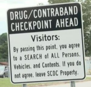 Smuggling is against the law per this sign.