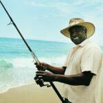 man holding fishing rod he rented on sanibel