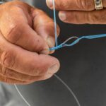 fishing lesson to tie hook to line