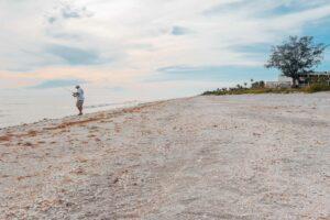 sanibel visitor fishing at island inn hotel beach