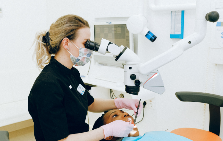 Dentist working on a girl's mouth