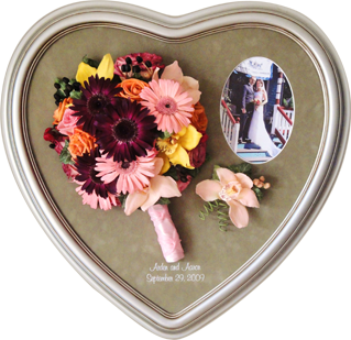 Preserved floral keepsake in a heart frame.