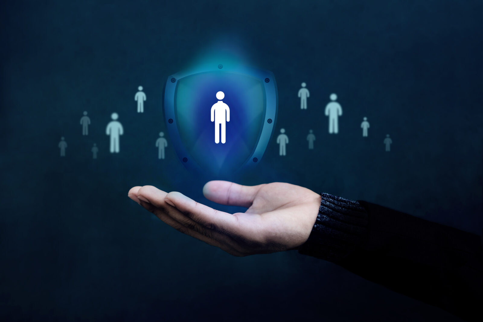 Life Insurance Concept. Company Supporting and Protecting their Customer by Shield, Human Icon floating over a Careful Gesture Hand of a Businessman