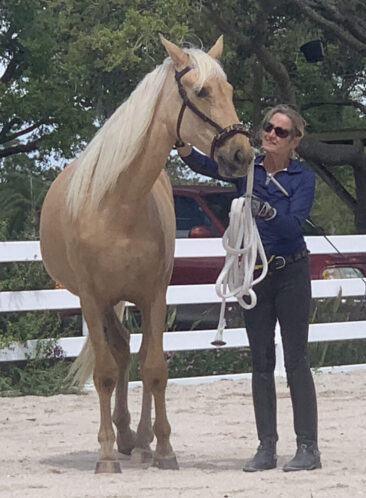 Mohican, a palomino filly with trainer Martha Dodd
