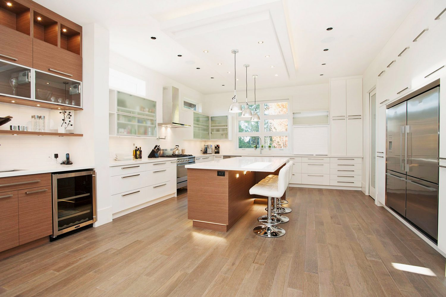 Forest interior designed white kitchen with rich wood accents by Midland Premium Properties in Vancouver, BC