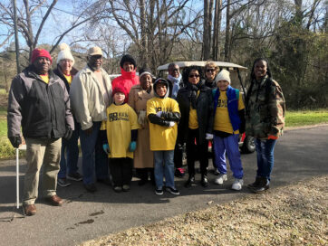 men and women, boy and girls, posing for a picture on the trail while participating in the MLK Day of Service