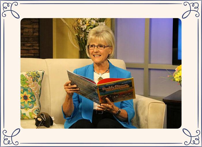 Ilona reading Buddy Bison's Yellowstone Adventure