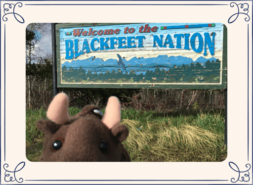 Buddy Bison plush in front of Blackfeet Nation sign
