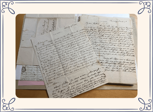 papers and documents with old handwriting on a desk