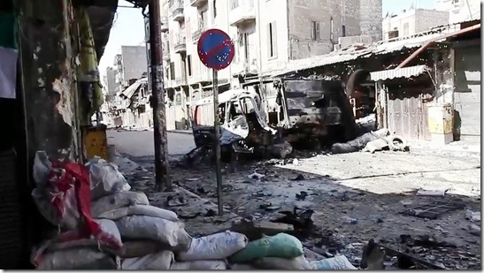 Bombed out vehicles Aleppo Syria
