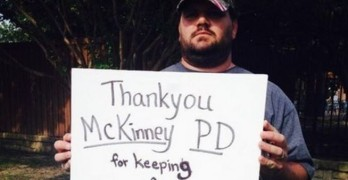 Sean Toon, with sign thanking police