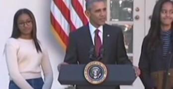 President Obama w- Sasha and Malia pardons turkey Honest & Abe.