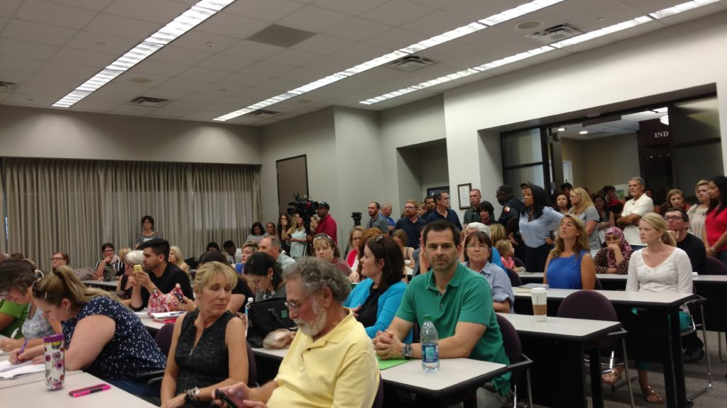 Large crowd of Humble ISD Parents at school board meeting