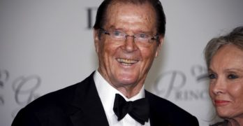 FILE PHOTO: British actor Roger Moore and his wife Kristina Tholstrup arrive at the Princess Grace Awards gala in Monaco