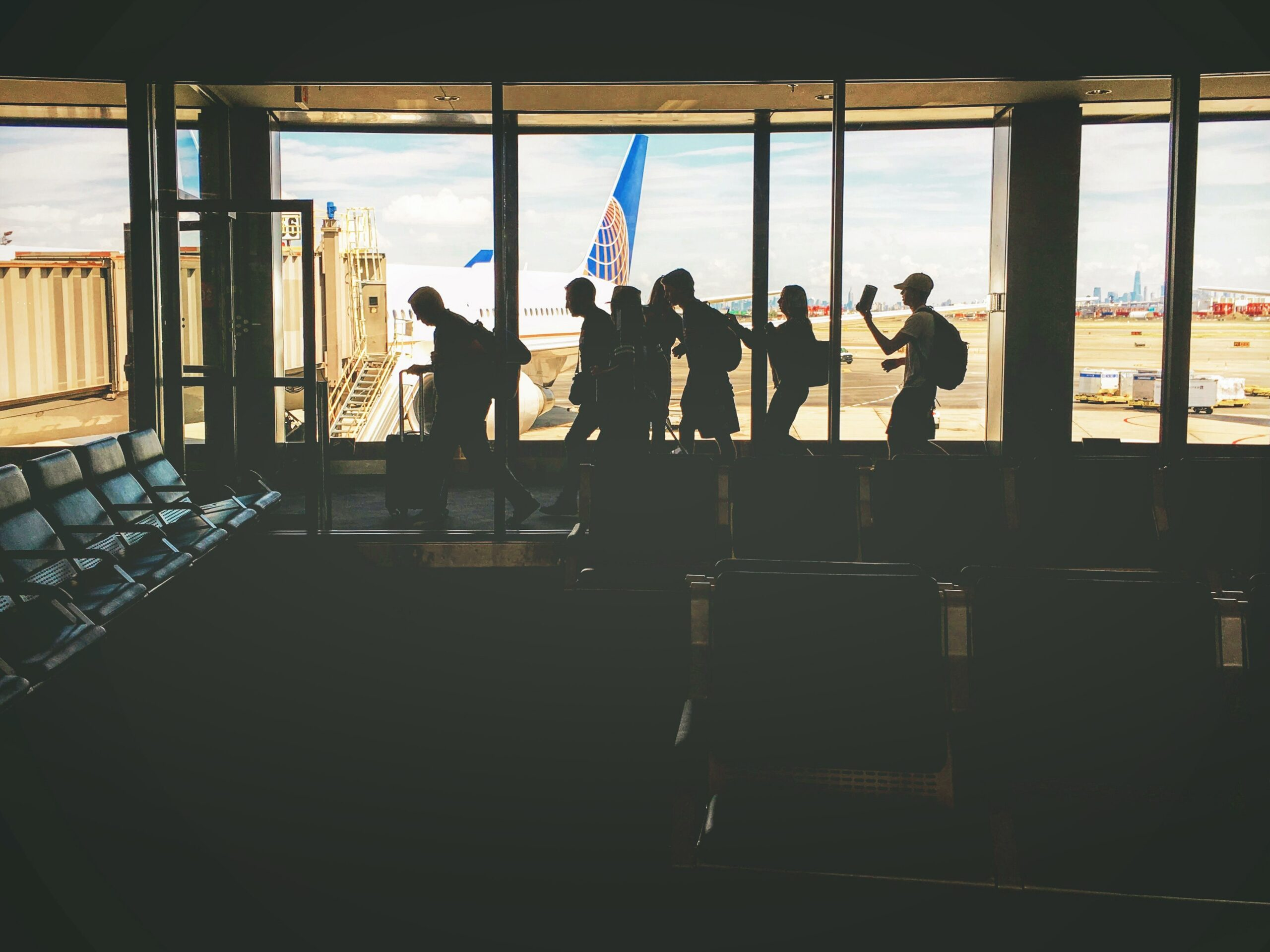 group-of-people-walking-near-clear-glass-window-with-a-view