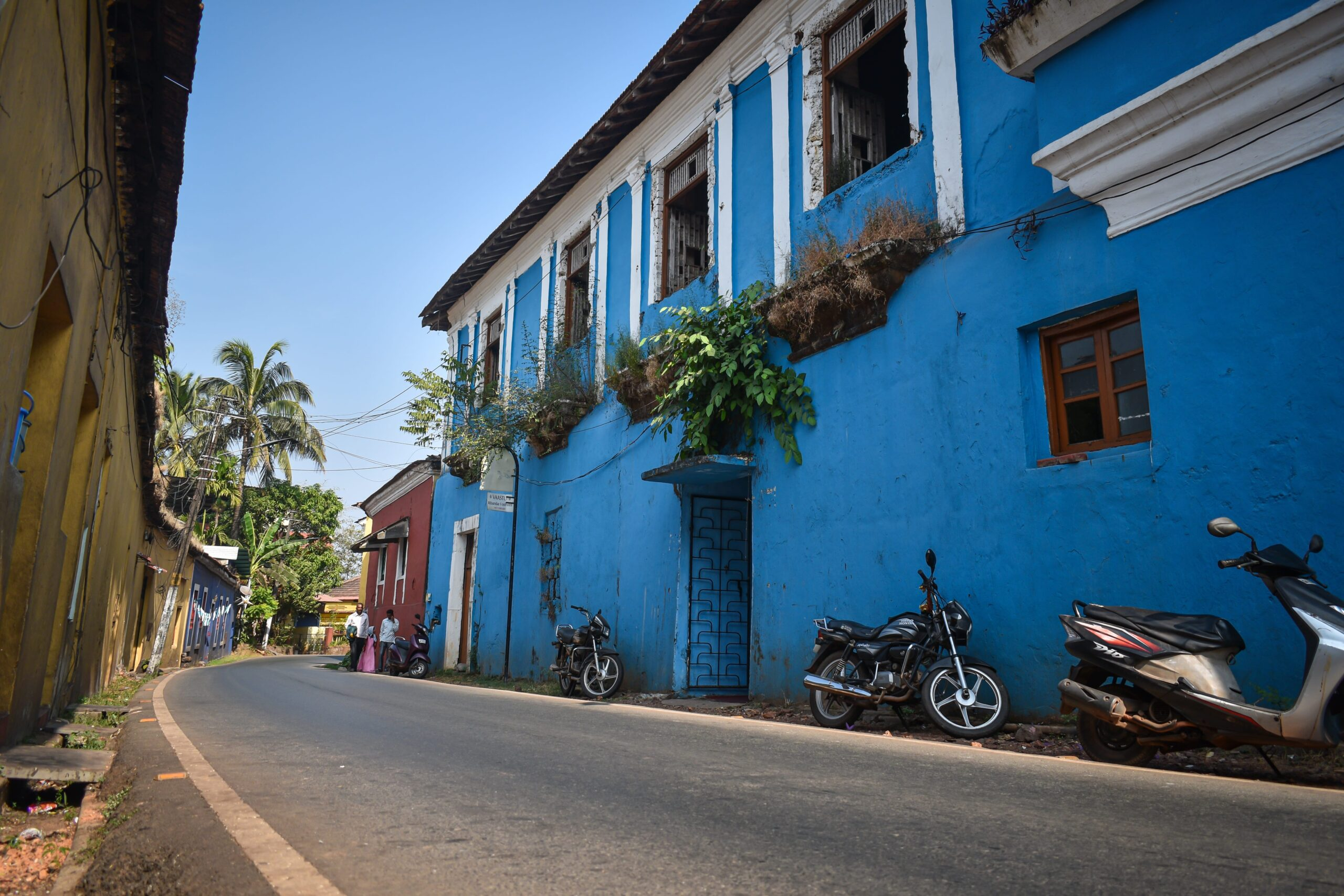 Streets of Old Goa surrounded by colorful buildings